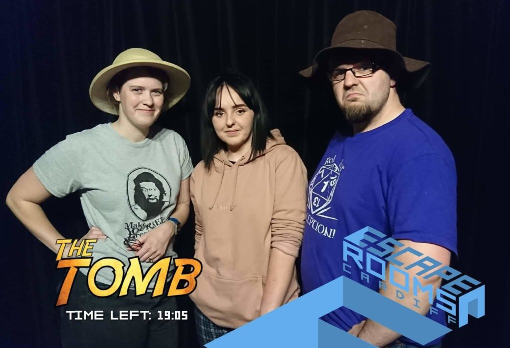 Three team members at The Tomb at Escape Rooms Cardiff after wining the game